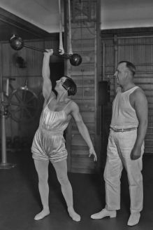 A woman lifting a dumbbell in a gym circa 1930. (Photo by Max Haas/FPG/Getty Images)